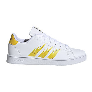 Levně Bílo-žluté tenisky Adidas Advantage K